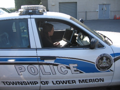 Intern in Police Car